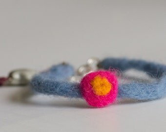 you're a star flower felted wool bracelet with a star bead