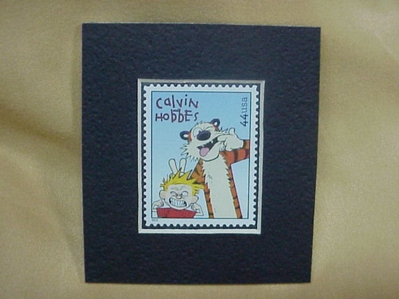 Matted unused U.S. postage stamp of comic strip Calvin and Hobbes