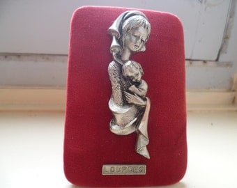 Souvenir from Lourdes, red velvet backed pewter figurine and wall plaque.