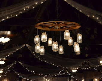 alternating wagon wheel mason jar chandelier large alternating length wagon wheel mason jar