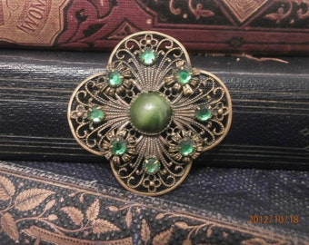 Beautiful brooch with emerald green stones -May Birthstone