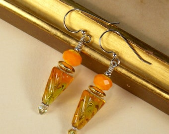 Orange and green glass and crystal earrings with gold accents on silver toned ear wires