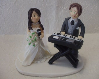 customized bride and groom with musical keyboard  wedding cake topper