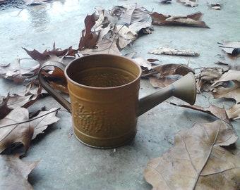 brass mini water can