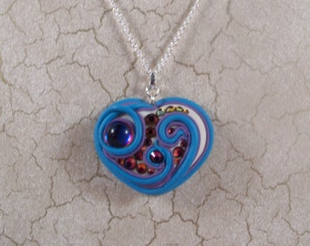 Heart shaped polymer clay pendant with Swarovski Crystal cabochons and flatbacks.