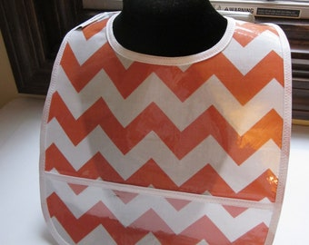 WATERPROOF WIPEABLE Baby to Toddler Wipeable Plastic Coated Bib Orange and White Chevron