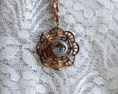 Vintage doll's eye on metal pendant necklace, gothic and fun