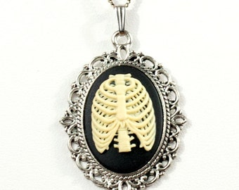 Spooky Gothic Steampunk Skeleton Rib Cage Cameo Necklace with Silver Filigree Setting by Velvet Mechanism