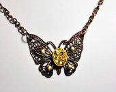 Victorian butterfly pendant necklace with gold  jeweled vintage watch parts movement rubies fashion  steampunk goth art  sculpture