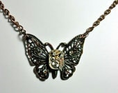Butterfly pendant necklace victorian vintage jeweled watch parts movement with rubies and crystals artist created in Michigan