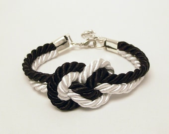 Black and white infinity knot nautical rope bracelet with silver anchor charm
