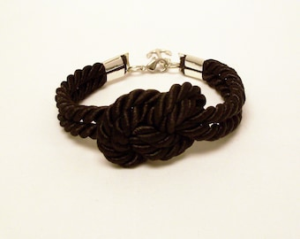 Black infinity knot nautical rope bracelet with silver anchor charm