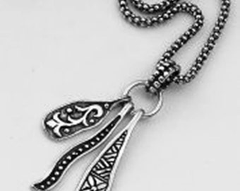 Elegant Silver pendants ethnic motifs