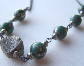 green and raw pyrite with mixed oxidized sterling silver chain in asymmetrical design - natural selection