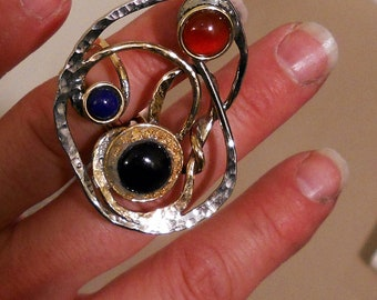 large ring with 3 stones