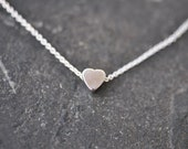 tiny silver heart necklace on delicate silver chain modern everyday minimal