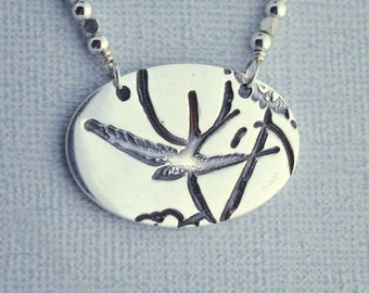 handmade jewelry - swallow pendant necklace - fine silver - PMC - precious metal clay - sterling - oval - Swooping Swallow