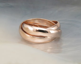 chunky rolling rings / Russian wedding bands -- hand forged in 14k rose gold