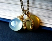 charm cluster necklace. chalcedony, horse shoe & tiny locket. delicate brass chain. by baltica