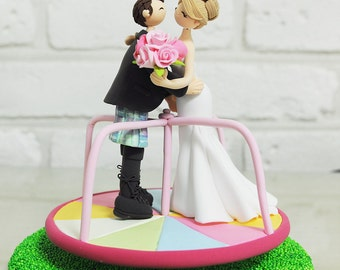 Couple on roundabout at playground wedding cake topper decoration
