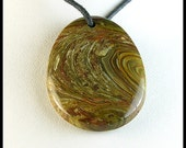 Swirls and Twirls on Oval Focal Bead Made From Carrasite