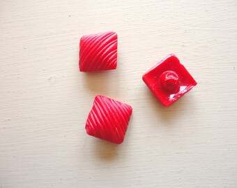 set of three red diamond shaped glass vintage buttons