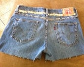 STUDDED and SPIKED Distressed Mid to High Waisted Faded Blue Denim Jean Shorts with Orange Stitching Pink Levis Patch Font Size 9S