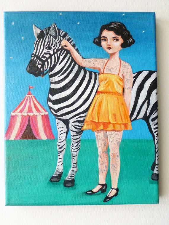 Vintage tattooed circus girl with zebra.