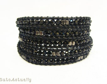 Black crystal wrap bracelet with metal beads on polyester cord