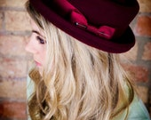 Ladies classic porkpie hat in oxblood burgundy.