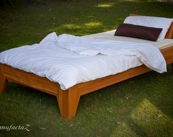 Comfortable bed made of solid cherry wood, oiled
