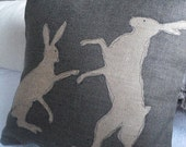 hand printed classic   charcoal rustic boxing hare cushion cover