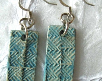 jewelry earrings made in turquoise blue in paper clay
