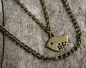 talora. a simple and sweet, little birdie, strand necklace.