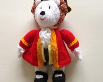 Hand knitted hedgehog with red coat