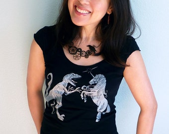 Unicorn vs. Dinosaur Women's Tshirt - Unicorn Shirt, Dinosaur Tshirt - Epic Showdown Graphic Tee Shirt
