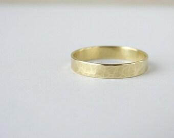 Minimalist brass band. Simple wedding band. Gold tone brass ring.