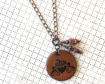 Acorn Necklace. Rust Glaze on Black Porcelain Square. Burnt Orange. Sienna. Copper & Striped Beads. Gunmetal Chain. Oak Leaves
