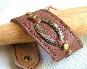 Stamped brass on brown leather cuff