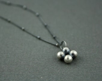 Sterling silver cast pendant on cable chain