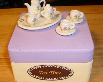 Wooden trinket box with an adorable glass tea set on top