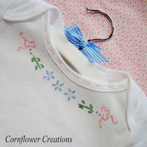 Ribbons and flowers for baby hand embroidered bodysuit by