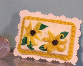 Miniature Spring themed sheet cake with yellow flowers