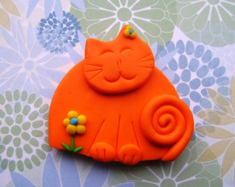 Polymer Clay Orange Cat with Yellow Flower pin or magnet
