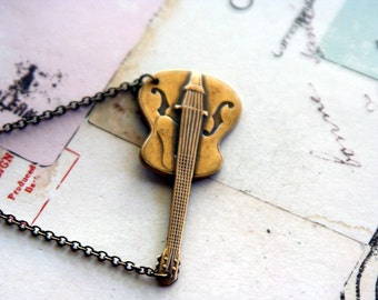guitar. necklace. brass ox