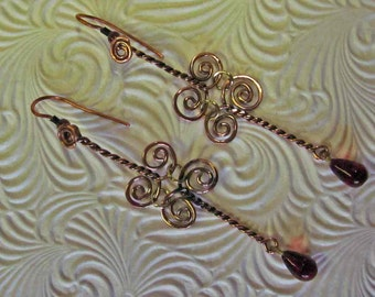 Copper Spirals with a drop of deep Ruby Red... wire twisted into earrings...