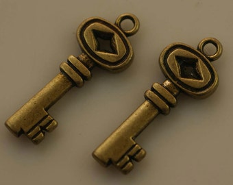 4 Bronze Plated Key Charms 33 mm   quantity four   ZZ6