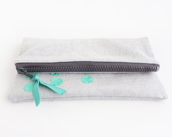 Light grey with mint fold over small clutch