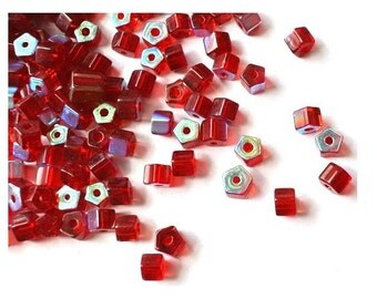 50 Vintage glass beads unique red, tube, faceted, 8mmx6mm