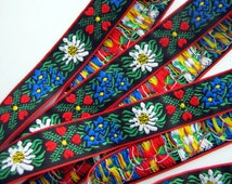 EDELWEISS & HEARTS Jacquard trim. 3 yards. White, Blue, red, green, yellow on black. Red edges. 1 inch wide. 949(2)-A Bavarian dress trim